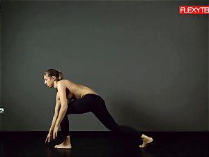 brunette gymnast displaying of her bum