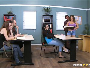 Jean Michaels plows her educator in the classroom