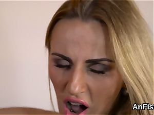 spectacular lesbian honies are widely opened and knuckle fucking culo holes
