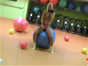Sabrina light-haired blonde lady wearing a pink rope on