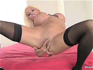 Russian milf Nikita fingers her cock-squeezing slit
